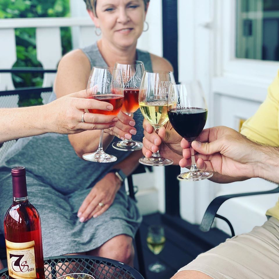 Friends toasting with Captain's Walk wines